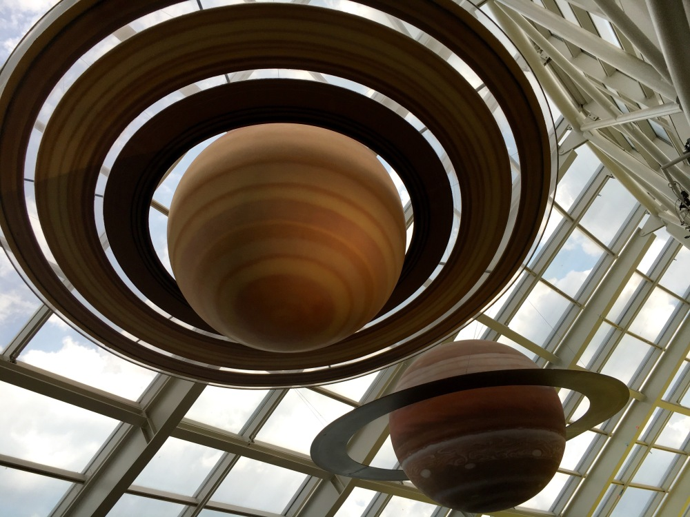 giant ringed planets hanging from a glass ceiling at Adler Planetarium in Chicago